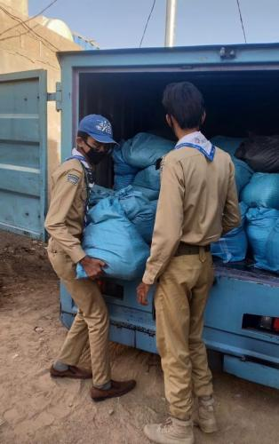Scouts and rangers helping SOCF in Ration distribtion to Single mothers.